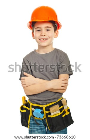 Happy worker boy with helmet and tools standing with arms folded isolated on white background - stock photo