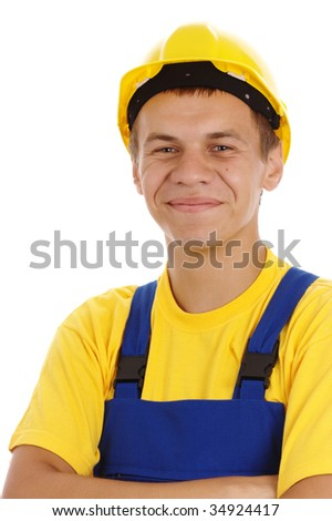 Happy worker fold his arms, dressed in blue-and-yellow uniform and hard hat, isolated over white - stock photo