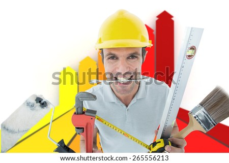 Happy worker with various equipment against orange red and yellow arrows - stock photo