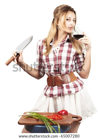 happy yang woman cutting vegetables for a salad  with glass of wine isolated on white - stock photo