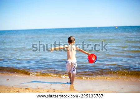 Happy 4 year old boy on the Baltic  sea  - stock photo