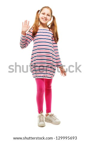 Happy 10 years old girl waving hand and smiling, with ponytails, isolated on white - stock photo