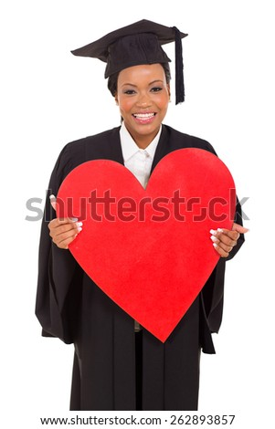 happy young african American college graduate holding heart shape over white background - stock photo