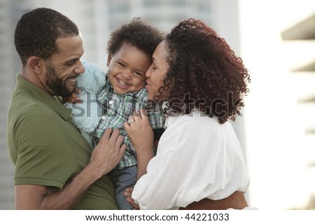 Happy young African American family - stock photo