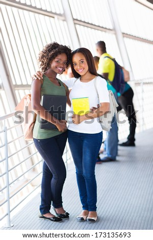 happy young african female college friends on campus - stock photo