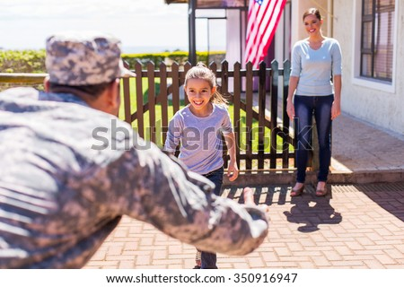 happy young american military family reunion  - stock photo