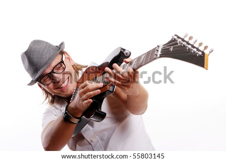 happy young and attractive man with guitar - stock photo