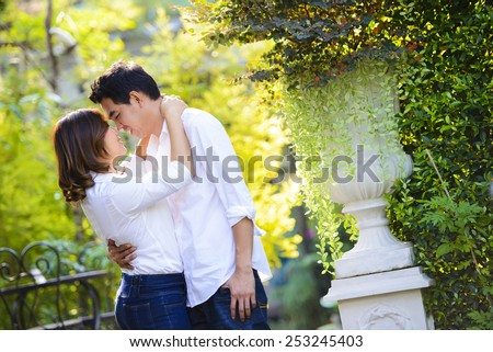 Happy young asian couple in love embracing - stock photo