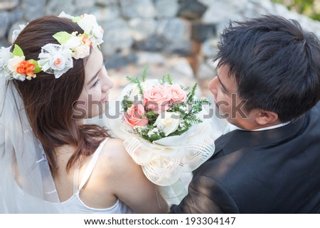 Happy young asian couple in love outdoor - stock photo