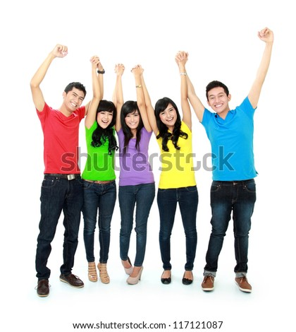 happy young asian people with arm raised - stock photo