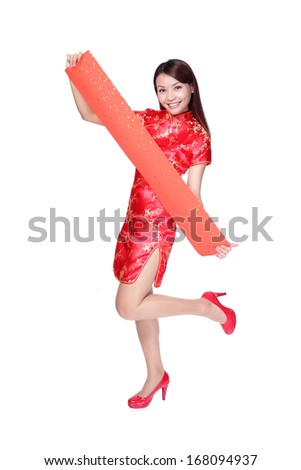 Happy young asian woman holding blank red couplets for celebrating chinese new year - stock photo