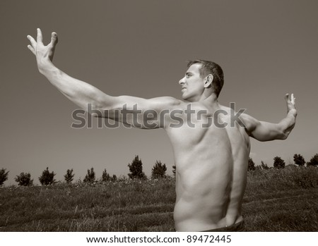 Happy young athletic man - stock photo