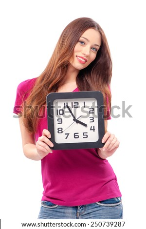 Happy young attractive caucasian woman holding office clock, isolated on white background - stock photo