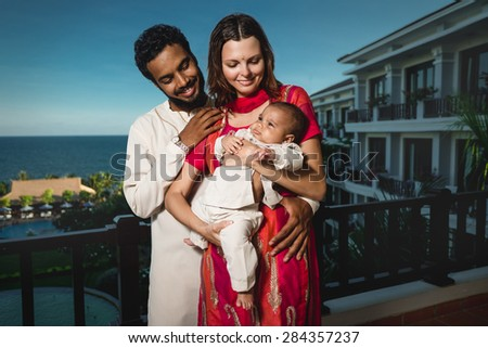 Happy Young Attractive Mixed Race Family with Newborn Baby - stock photo