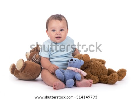 Happy young baby and toy bears isolated in white - stock photo