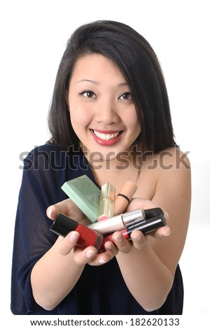happy young beautiful asian american showing make up set isolated on white background in glamour and fashion concept - stock photo