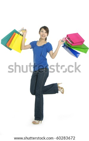 happy young beautiful girl with the bags - stock photo