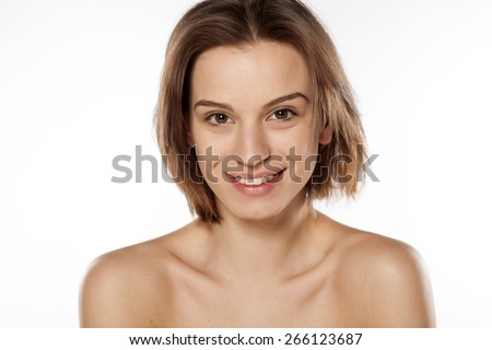 Happy young beautiful girl without make up on white background - stock photo