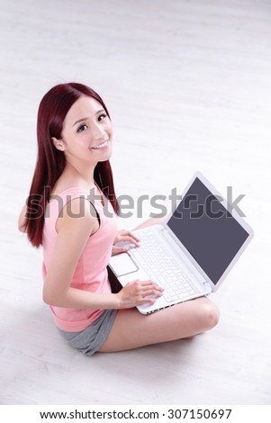 Happy young beautiful woman relax sit and using laptop computer pc at home, asian beauty - stock photo