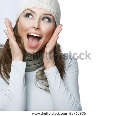 Happy Young Beautiful Woman.Surprised winter Girl over white - stock photo