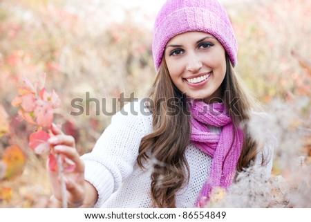 happy Young beautiful woman wearing winter clothing - stock photo