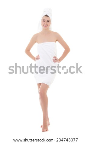 happy young beautiful woman wrapped in towel isolated on white background - full length - stock photo