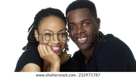 Happy Young Black couple looking at camera smiling - stock photo