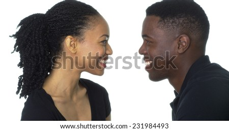 Happy Young Black couple looking at each other smiling - stock photo
