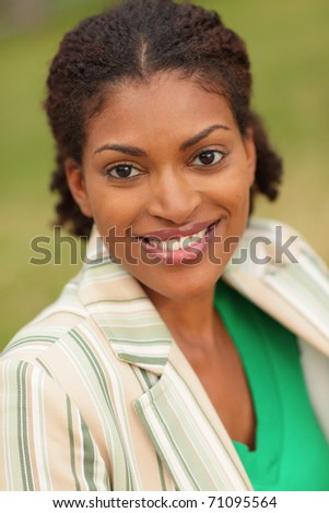 Happy young black woman - stock photo