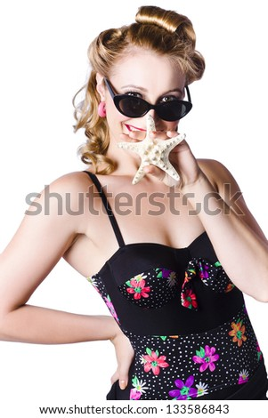 Happy young blond woman in retro style swimming costume holding sea star, beach holiday concept on white background - stock photo