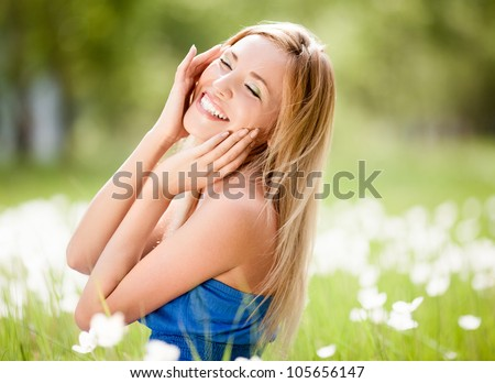 happy young blond woman outdoor on a summer day - stock photo