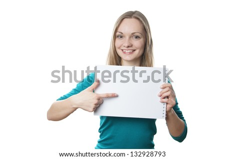 happy young blonde woman holding blank sign and pointing to copy space - stock photo