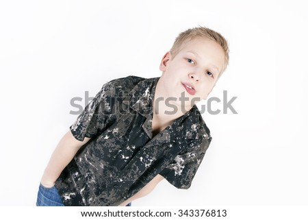 Happy young boy play the ape, shows tongue and grimace on a t-shirt, composition isolated over the white background - stock photo