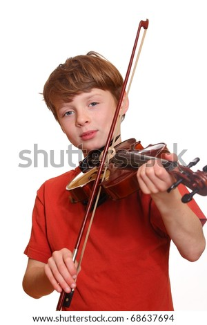 Happy young boy playing violin isolated on white background - stock photo
