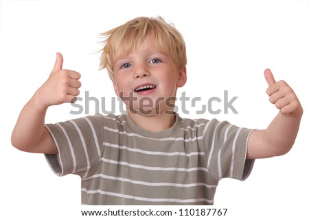 Happy young boy shows thumbs up on white background - stock photo