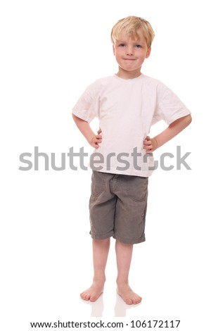 Happy young boy standing on white background - stock photo
