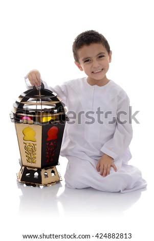 Happy Young Boy with Big Fanoos Celebrating Ramadan Isolated on White Background - stock photo