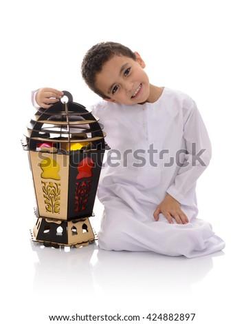 Happy Young Boy with Big Lantern Celebrating Ramadan Isolated on White Background - stock photo