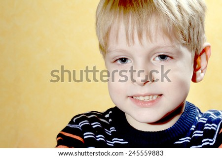 Happy young boy with smile on his face - stock photo