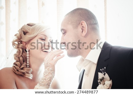 Happy young bride and groom on their wedding day. Wedding couple - new family. wedding dress. Bridal wedding bouquet of flowers. - stock photo