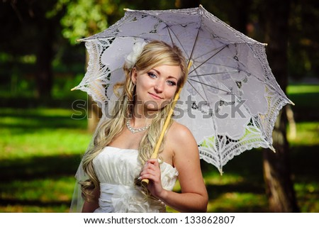 Happy young bride outside on wedding day - Copyspace. Wedding couple - new family! wedding dress. Bridal wedding bouquet of flowers - stock photo