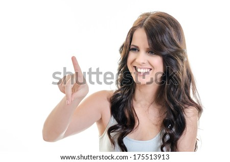 Happy Young Brunette Woman Touching Imaginary Screen with Her Finger - over white - stock photo