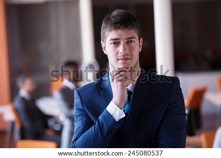 happy young business man portrait in bright modern office indoor - stock photo