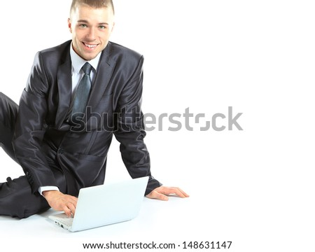 Happy young business man working on a laptop, isolated on white background - stock photo