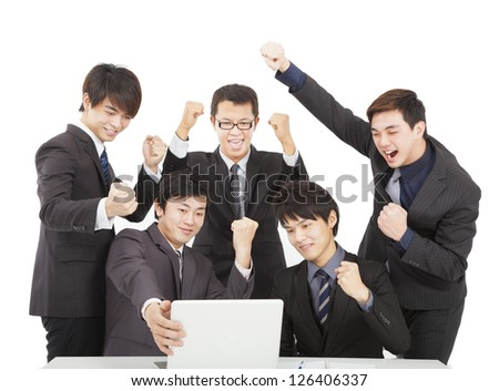 happy young business team  in the office - stock photo