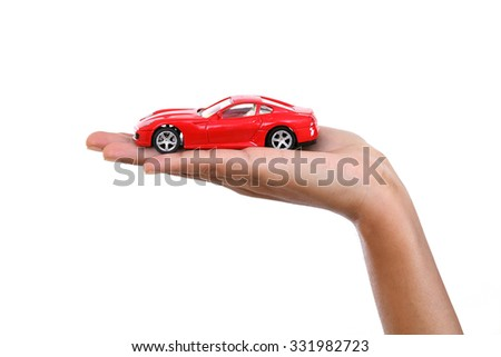 Happy young business woman holding toy car - stock photo