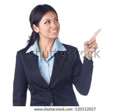 Happy young business woman pointing at something against white background - stock photo