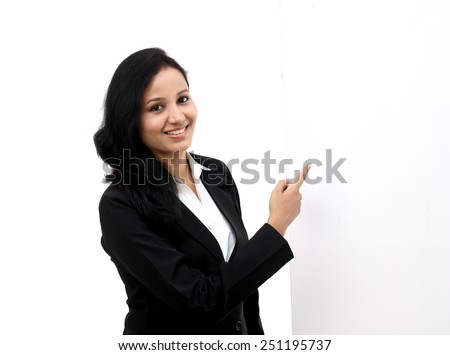 Happy young business woman showing blank signboard - stock photo