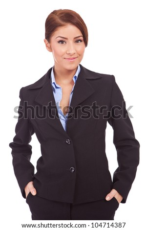 Happy young business woman with her hands in her pockets on white background - stock photo