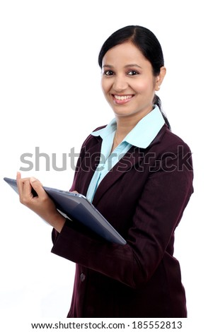 Happy young business woman with tablet against white background - stock photo